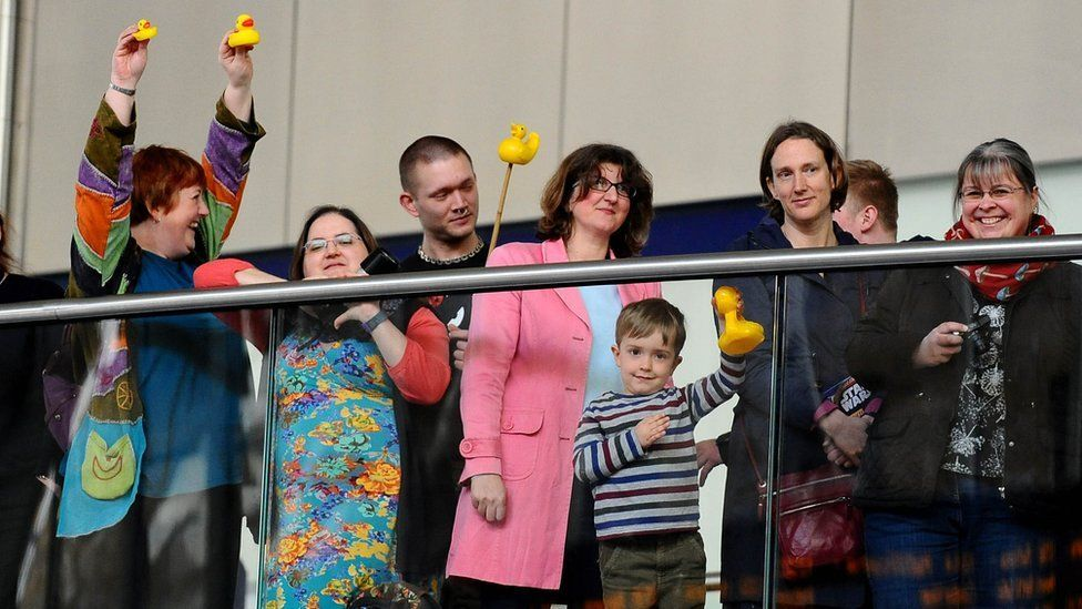Pro-duckists with rubber ducks at the unveiling of the Sir Nigel Gresley statue
