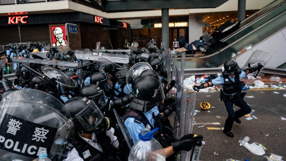 A police officer throws a teargas canister during a protest on June 12, 2019 in Hong Kong China.