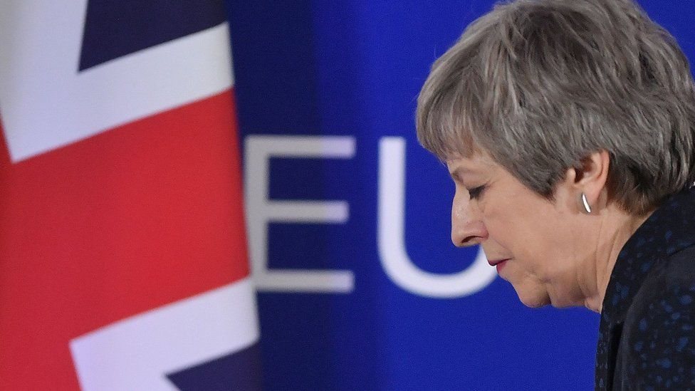 British Prime Minister Theresa May walks away after holding a press conference in Brussels on March 22, 2019