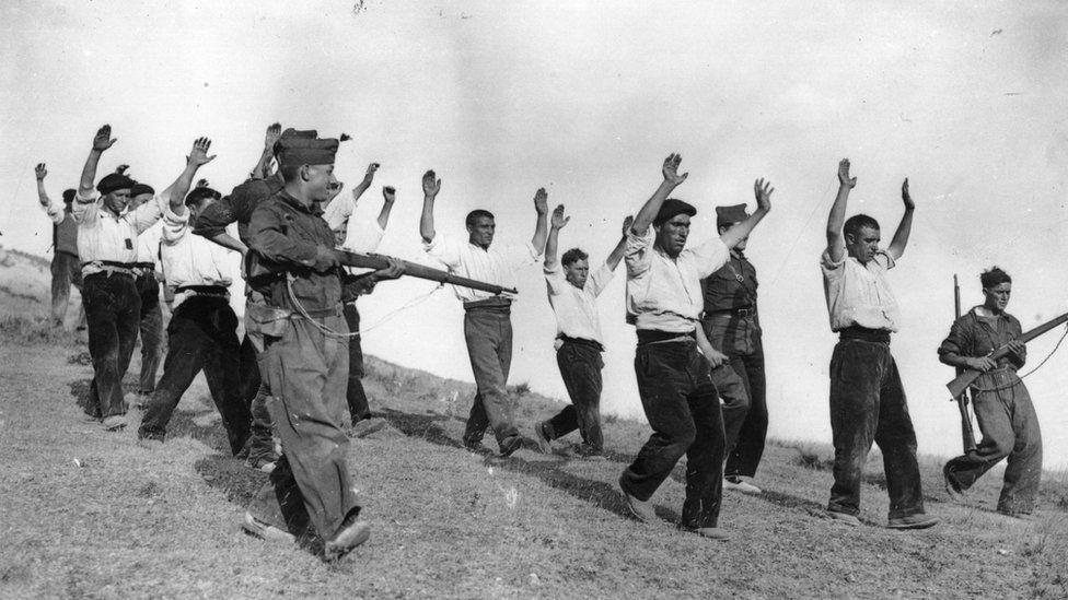 Nationalist troops capture Republicans during the Spanish Civil War