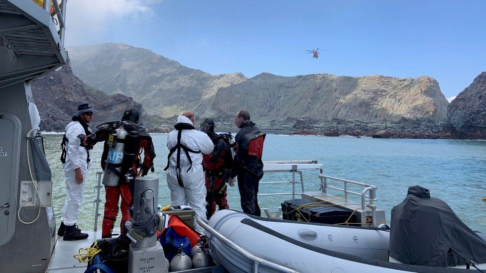 Members of a dive squad conduct a search during a recovery operation around White Island