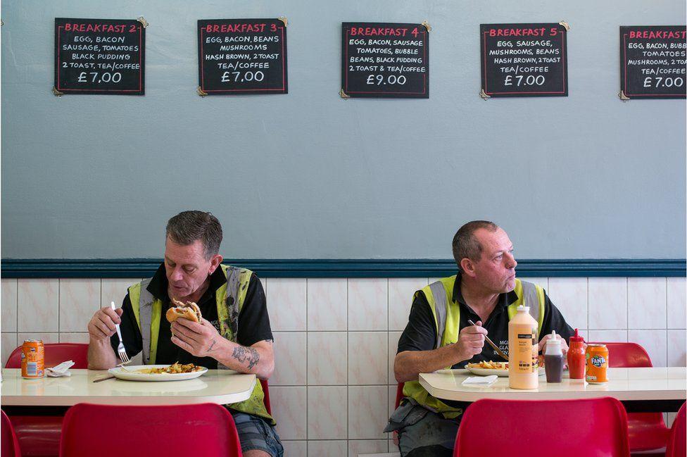 Two men eating