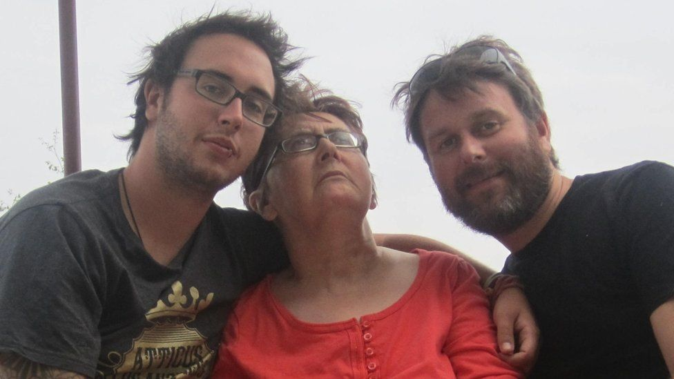 Lee Pearce (right) with his mum and brother