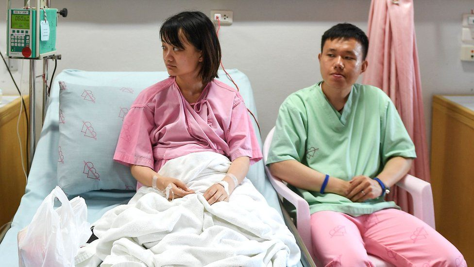 Rescued passengers of the capsized tourist boat in rough seas Wu Jun 28 (R) and his wife Long Haining 29 (L) in Phuket, 6 July 2018