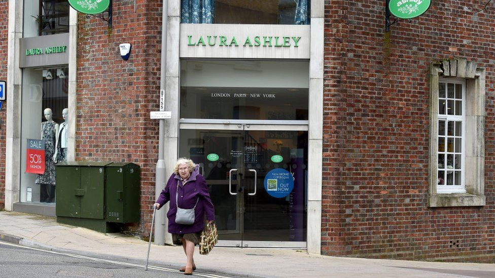 Lady walks out of Laura Ashley