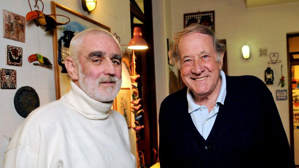 Andrew Graham-Yooll with Robert Cox (r)
