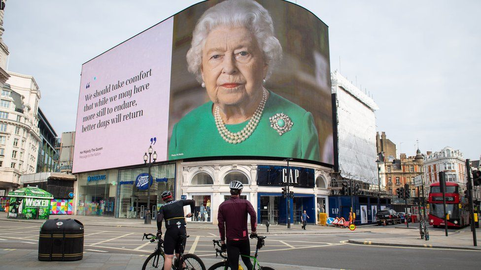 "An image of Queen Elizabeth II and quotes from her broadcast on Sunday to the UK and the Commonwealth in relation to the coronavirus epidemic are displayed on lights in London""s Piccadilly Circus."