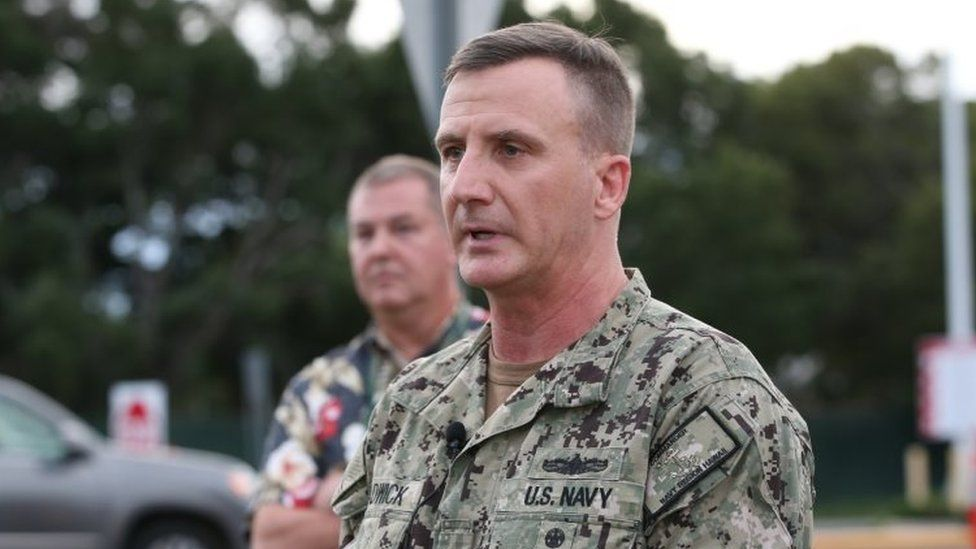 Rear Admiral Robert Chadwick answers questions at a press conference