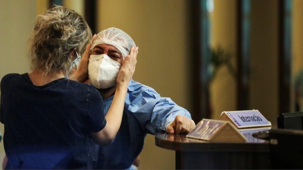 A health worker reacts at Getulio Vargas hospital, amid the coronavirus disease