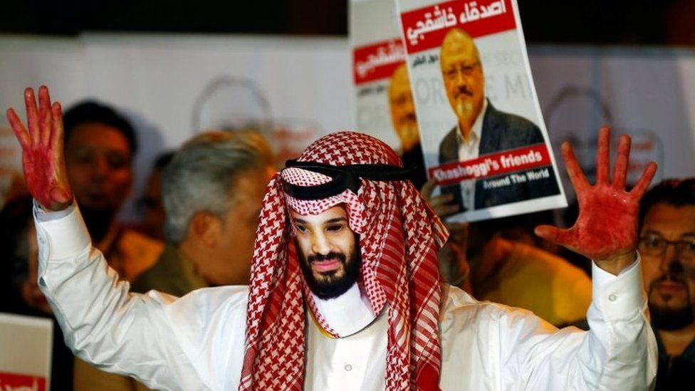 A protester with red paint on his hands wears a mask of Saudi Crown Prince Mohammed bin Salman at a rally in Istanbul, Turkey. Photo: October 2018