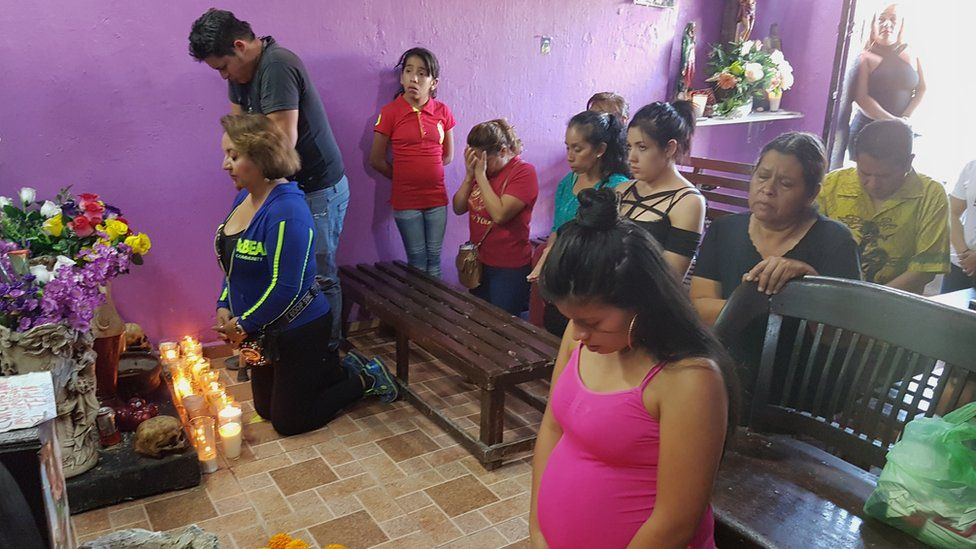 A group of people prays to Santa Muerte in Guadalajara