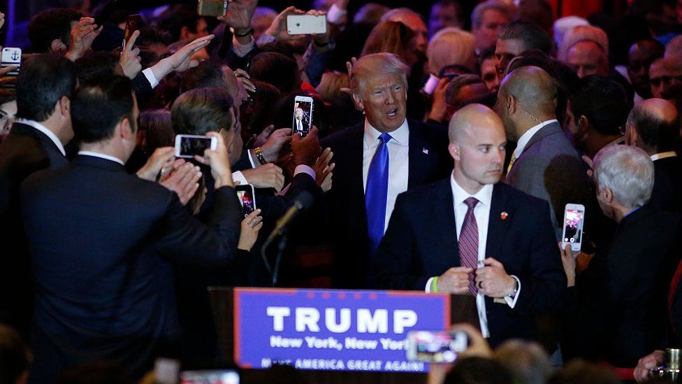 US Republican presidential frontrunner Donald Trump arrives for a celebration rally at Trump Tower in New York on April 26, 2016 after winning primaries in Pennsylvania, Maryland, Connecticut, Rhode Island and Delaware