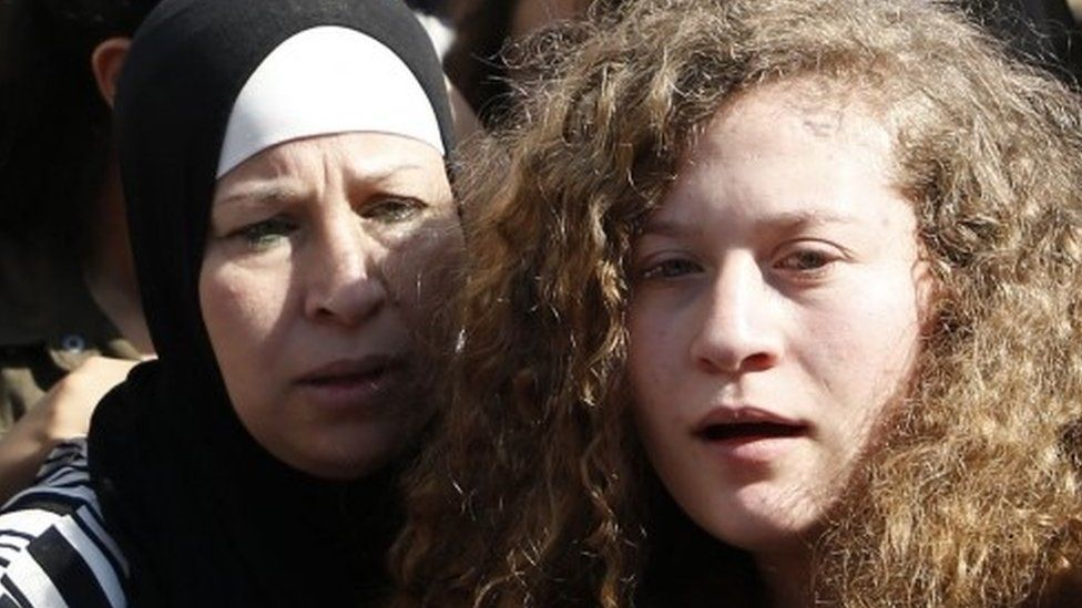 Ahed Tamimi (R) and her mother Nariman