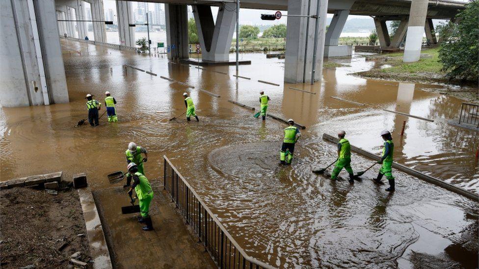 Workers under the Jamsu Bridge near the Han River in Seoul, South Korea, 04 August 2020
