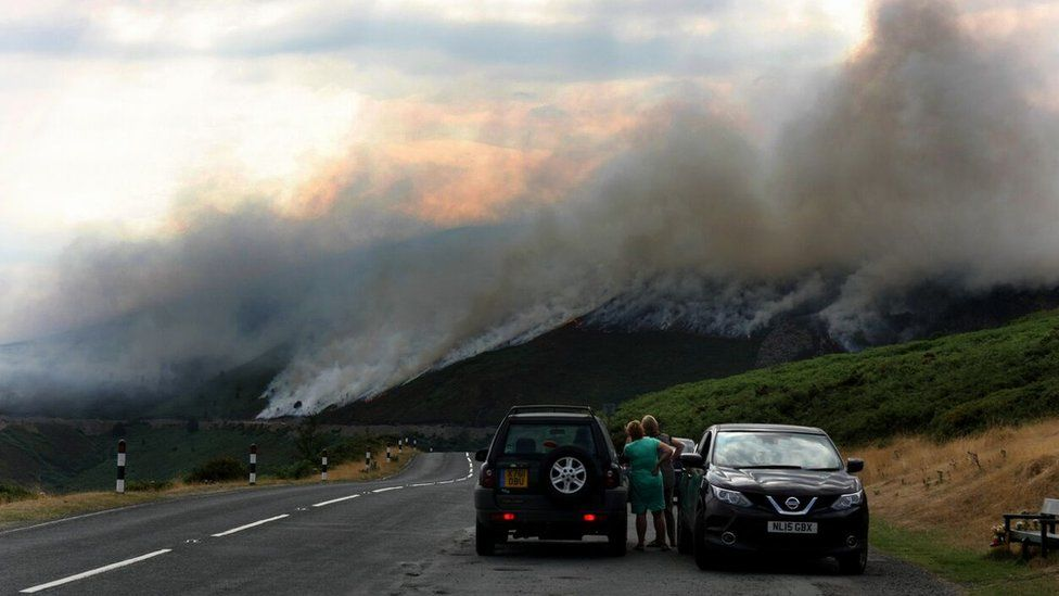 Motorists watch the wildfire above Horseshoe Pass in North Wales