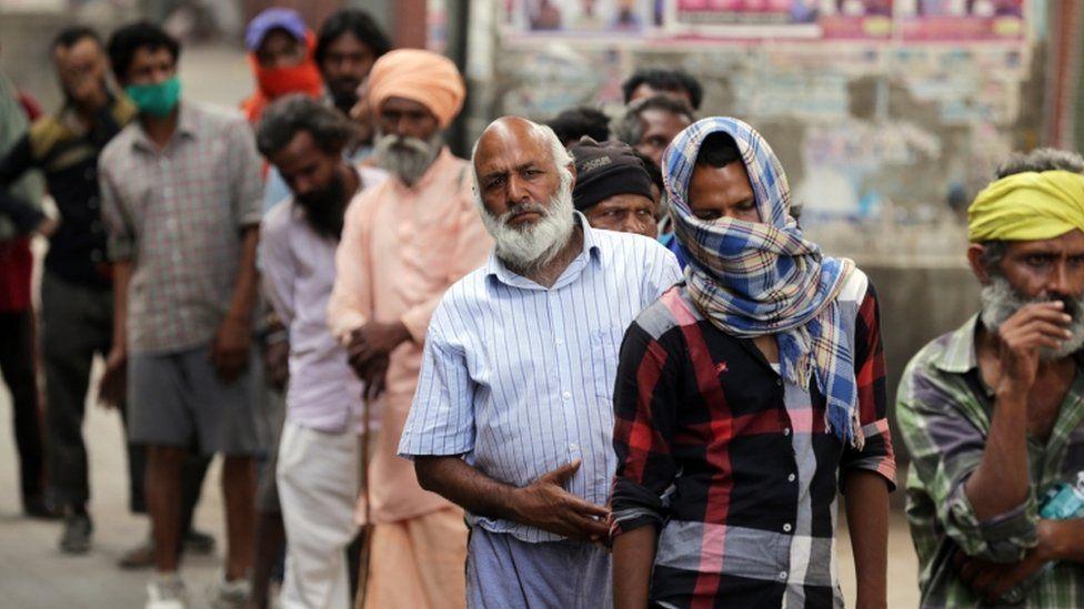 Underprivileged Indians queue for tea in Amritsar