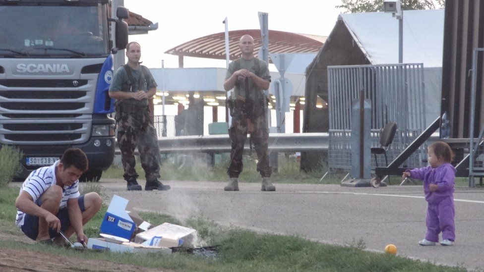 Asylum seekers at Kelebia, Serbia, waiting to enter the Transit Zone in the Hungarian fence, 12 September 2016