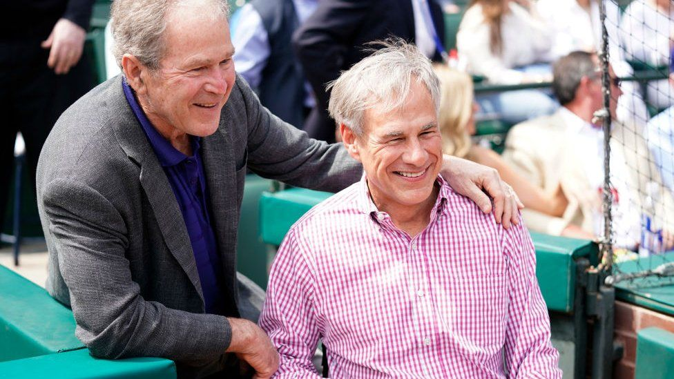Governor Abbott at a baseball game with former president George W Bush
