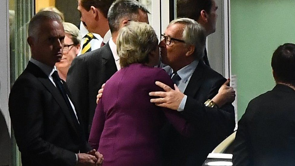 Mrs May and Mr Juncker embrace after the dinner in Brussels