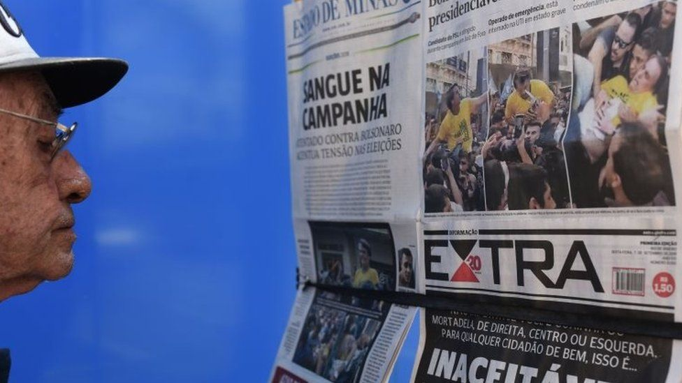 A man looks at the front pages of newspapers on the attack against Brazilian presidential candidate Jair Bolsonaro in Juiz de Fora,