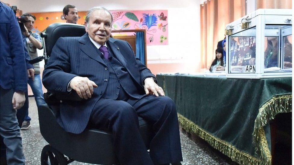 Algerian President Abdelaziz Bouteflika is seen on a wheelchair as he casts his vote at a polling station in Algiers during parliamentary elections, 4 May 2017.