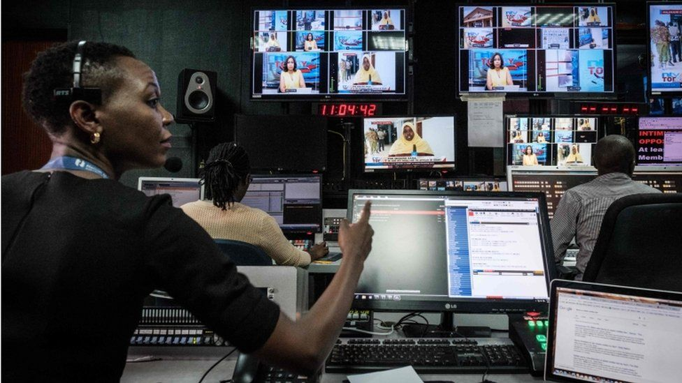 """Staff work in a control during a news program at NTV studios in Nairobi on February 6, 2018. The Government disconnected three major Kenyan television channels, NTV, KTN News and Citizen TV, during their live coverage of Raila Odinga as he swore himself in on January 30, 2018, as """"people""""s president,"""" despite losing in flawed elections last year. NTV and KTN News resumed broadcasts yesterday but Citizen TV remains to broadcast on internet only."""