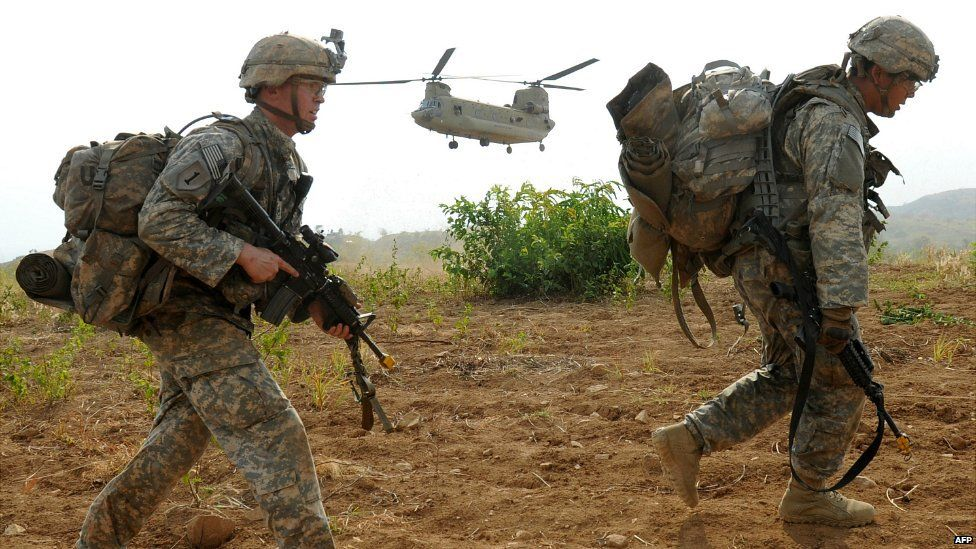 US army soldiers disembark from a C-47 Chinook helicopter during a training exercise in the Philippines - 20 April 2015
