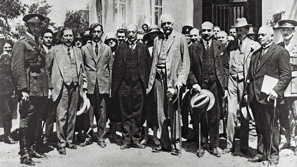 Photo taken in 1925 shows Arthur Balfour (C) and Chaim Weizmann (3rd-R), the then future first President of Israel, visiting Tel Aviv