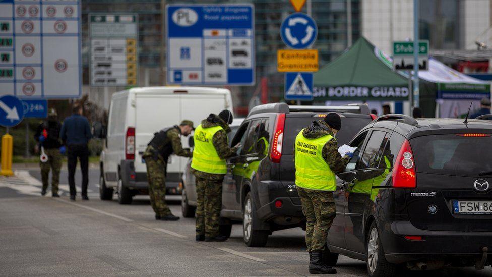Border control guards stop cars before crossing German/Polish border at Slubice/Frankfurt (Oder) on March 20, 2020