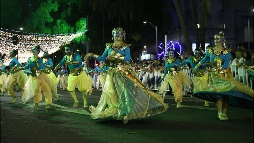 Dancers dressed as genies take part in the annual parade in Medellín