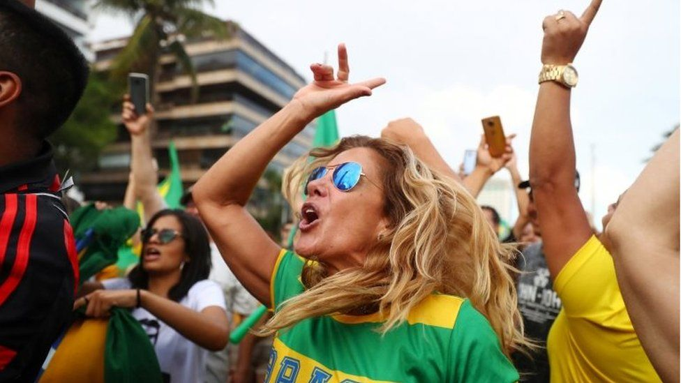 Supporters of Jair Bolsonaro cheer in Rio