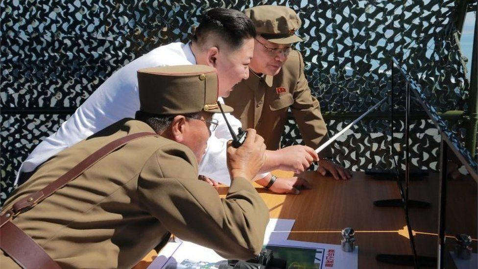 This undated picture released from North Korea's official Korean Central News Agency (KCNA) on September 20, 2016 shows North Korean leader Kim Jong-Un (C) inspecting the ground jet test of a new type high-power engine of a carrier rocket for the geo-stationary satellite at the Sohae Space Center in North Korea.