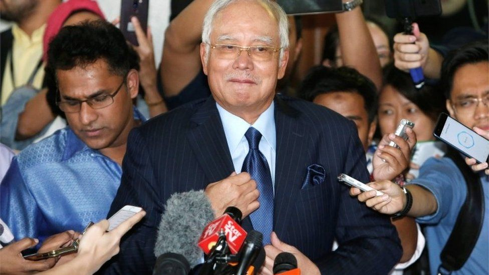 Malaysia's ex-PM Najib leave court in Kuala Lumpur where he faced a further 25 charges, 20 September 2018