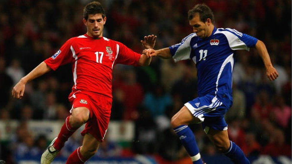 Ched Evans playing for Wales