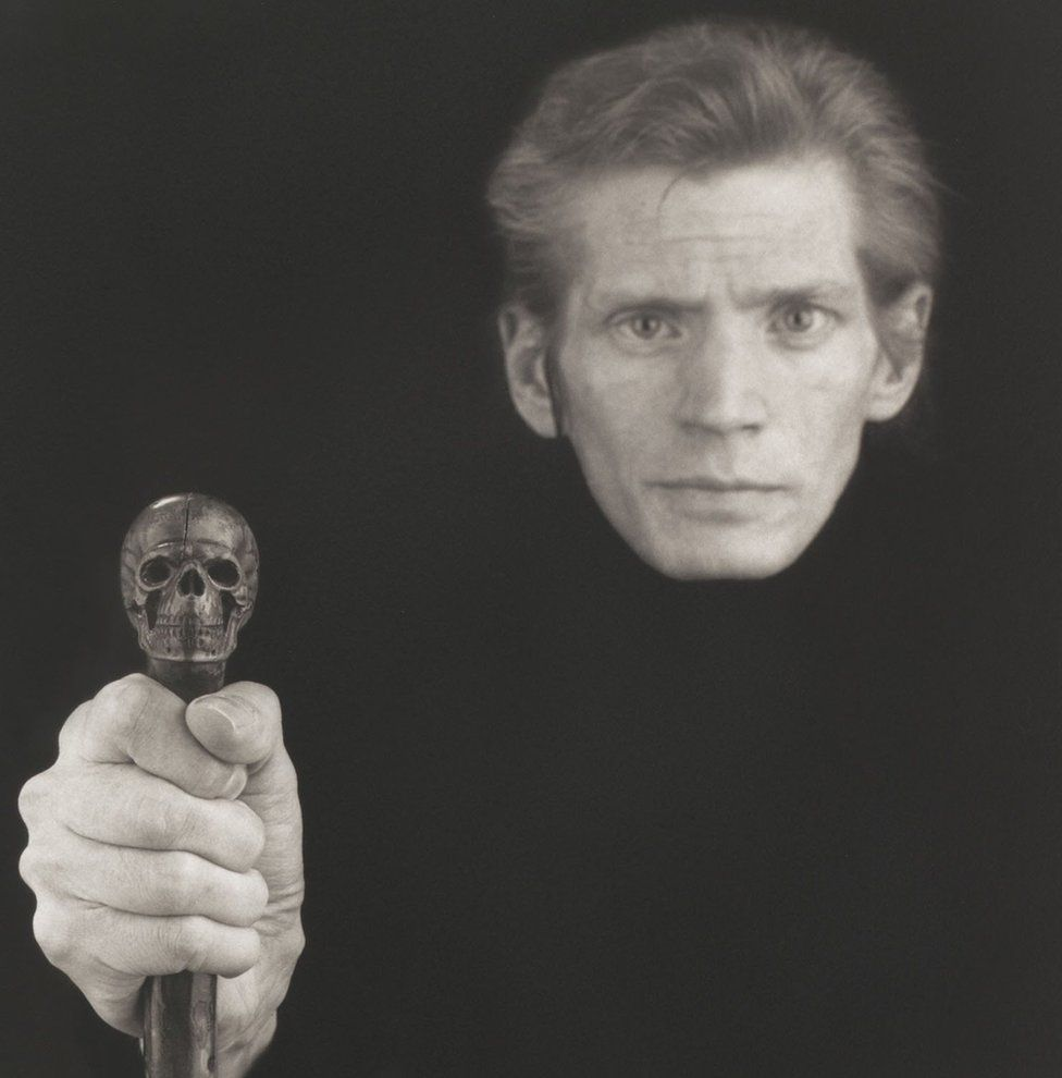 Robert Mapplethorpe self-portrait in 1989 shows him holding a skull cane in front of him - a reference to his battle with Aids