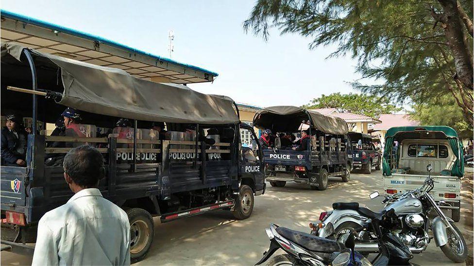 Police trucks in the town of Mrauk U