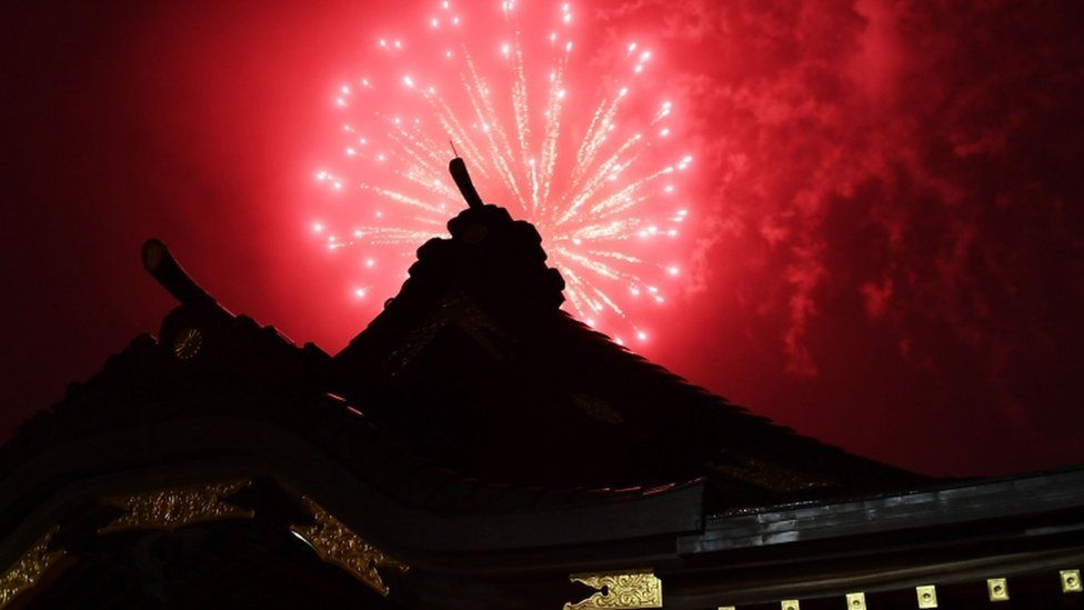 Fireworks explode over the Okunitama shinto shrine in Fuchu in the western suburbs of Tokyo