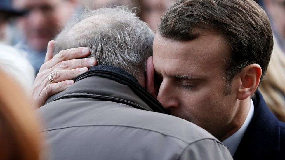 French President Emmanuel Macron gives his condolences to relatives of victims near the Bataclan concert venue during a ceremony marking the second anniversary of the Paris attacks of November 2015 in which 130 people were killed, in Paris, France, 13 November 2017