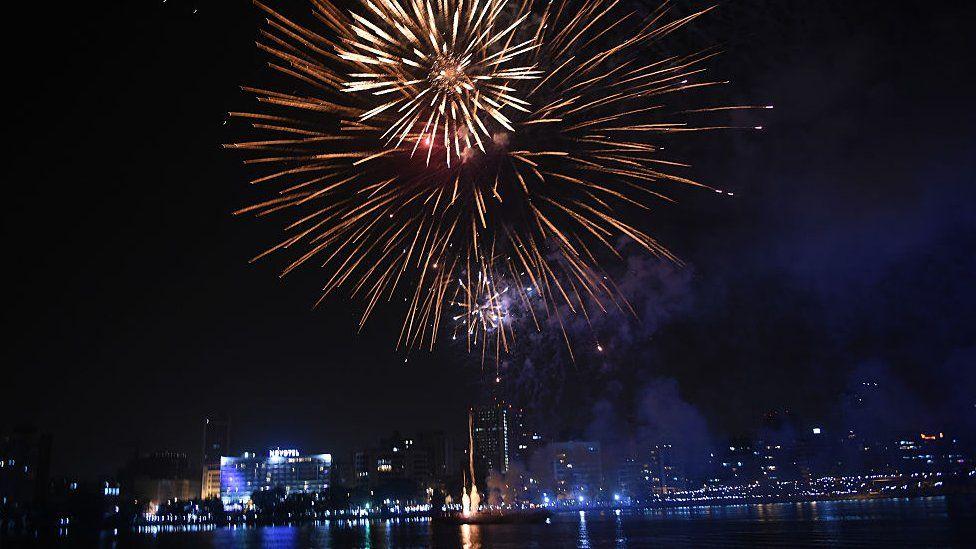 Fireworks light up night sky over Abidjan cityscape