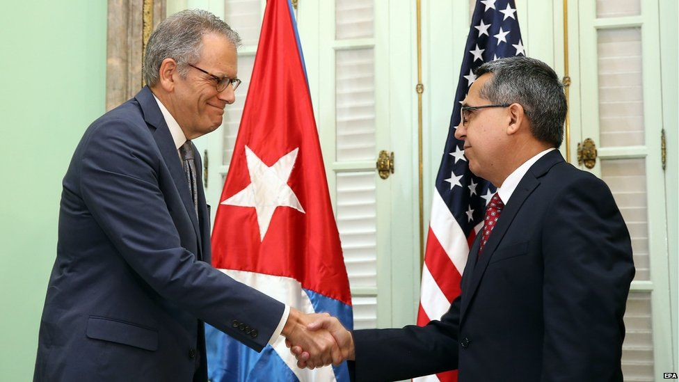 Chief of Mission at the US Interests Section in Havana Jeffrey DeLaurentis (L) meets Cuban interim Foreign Minister, Marcelo Medina (R), in Havana, Cuba on 1 July 2015