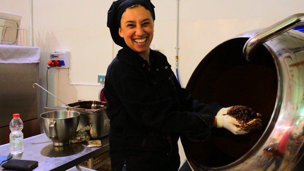 Karina Chepelinski working at the De Karina chocolate factory
