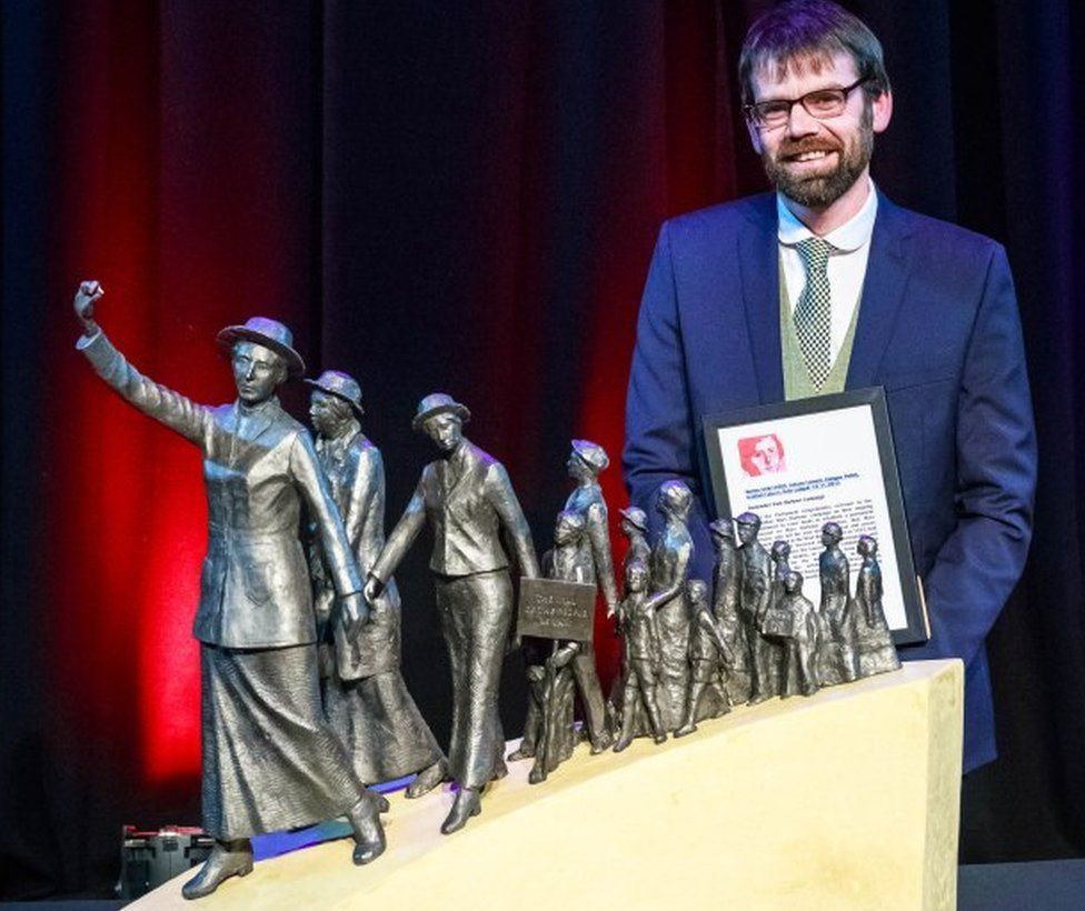 Sculptor Andrew Brown with his winning maquette