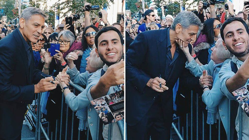 An elderly fan squeezes George Clooney's chin at the Toronto film festival