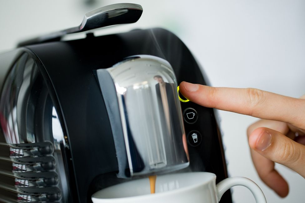 coffee being prepared with the new Coffee Capsule System 'Expressi' of the discount supermarket chain Aldi