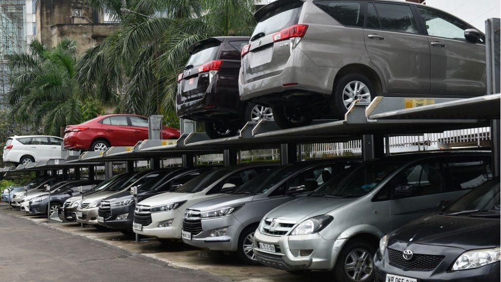 Fleet of Toyota cars can be seen parked in front of Toyota showroom in Kolkata, India, 15 September, 2020