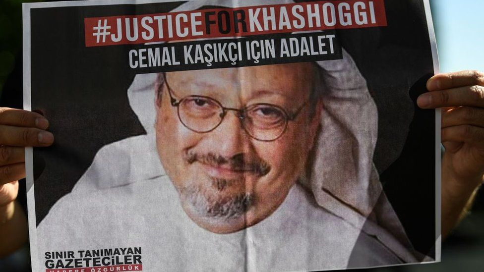 Friends of Jamal Khashoggi hold posters bearing his picture as they attend an event marking the second anniversary of his killing in Istanbul (2 October 2020)