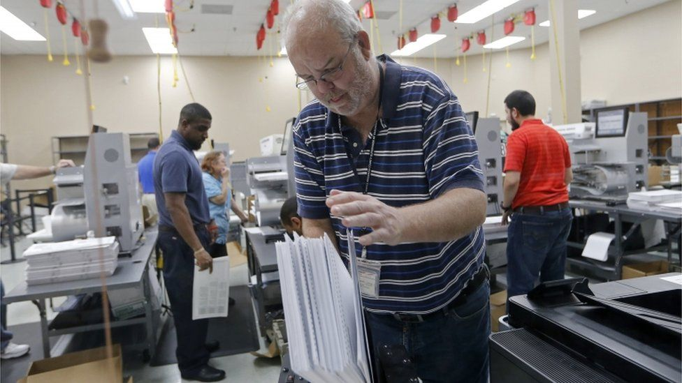 A device is used to straighten ballots before machine counting during a recount at the Broward County Supervisor of Elections office on November 11, 2018 in Lauderhill, Florida. A statewide vote recount is being conducted to determine the races for governor, Senate, and agriculture commissioner.