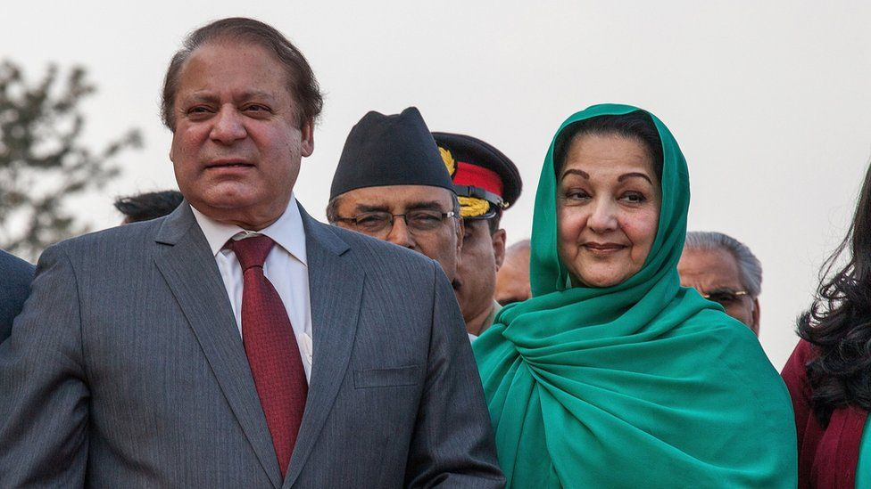 Prime Minister of Pakistan Nawaz Sharif poses with his wife, Kulsoom Nawaz Sharif, upon his arrival for the 18th SAARC Summit on 25 November 2014 in Kathmandu, Nepal
