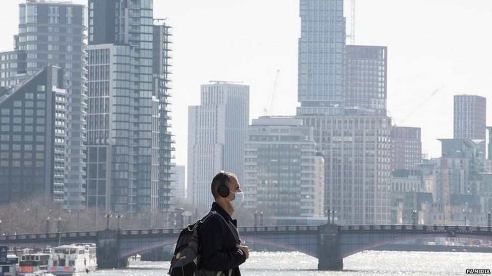 A man wearing a face mask in central London