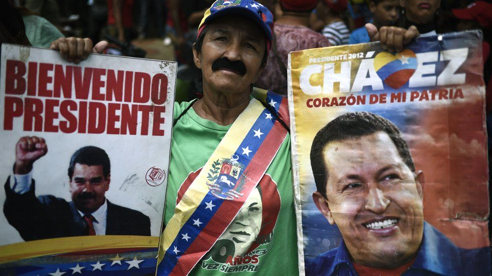 Supporters of Venezuela's President Nicolás Maduro take part in a march in Caracas, 13 April 2019